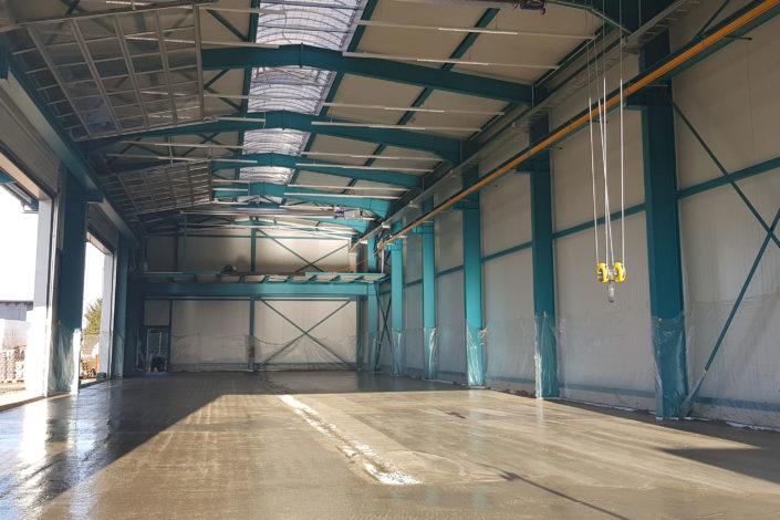 SF-Bau-Bodenplatte betonieren-Neubau Lagerhalle-Nellingen-Stahlbau-Schlüsselfertigbau